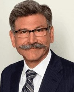 John E. Kusturiss