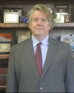 John E. Dunlap