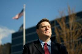 Matthew Benedict standing in front of the Robert P, Griffin Hall of Justice