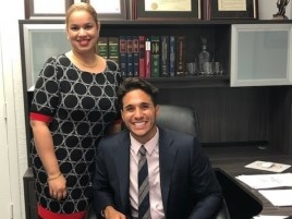 Attorney Christopher Alas and Chief Legal Assistant Arelis Escarfuller