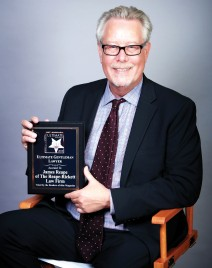 Shareholder James P. Reape, Esq. holding his 2019 Ultimate Attorney Award, as voted by Elite Magazine readers.